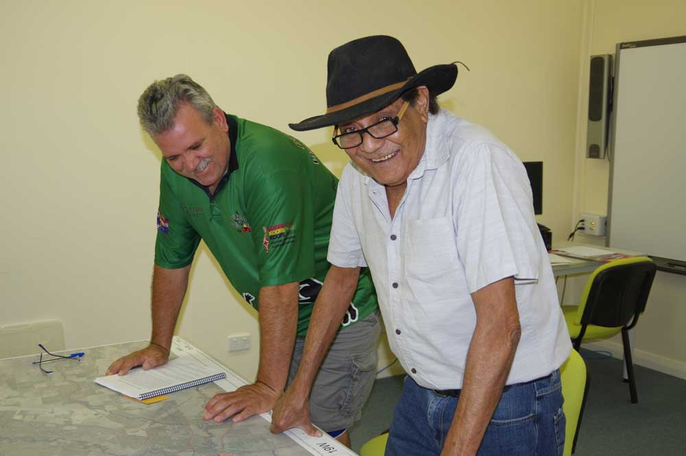 Stewart Taylor assists DEG's Bill Simpson to map his lifetime on country.